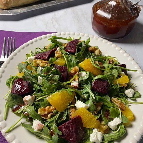 A salad with beets, oranges and goat cheese.