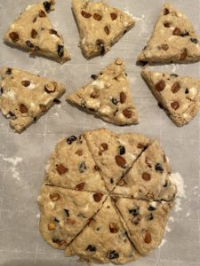 Scones on a cookie sheet before baking.